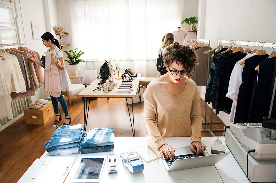 Woman working in small business clothing store